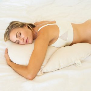woman sleeping on stomach using billow pillow