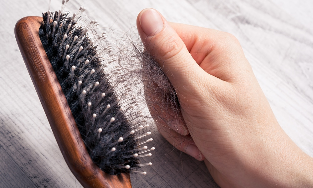pulling hair out of a brush